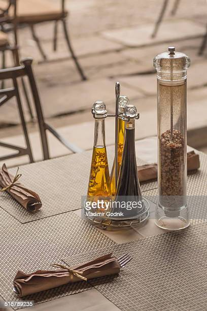 Seasoning bottles and napkins on table in restaurant