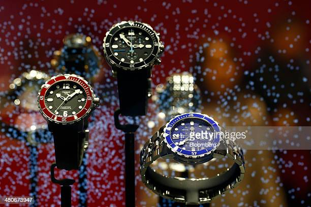 Seastar 1000 wristwatches produced by Tissot a unit of Swatch Group AG sit on display at the company's booth during the Baselworld luxury watch and...
