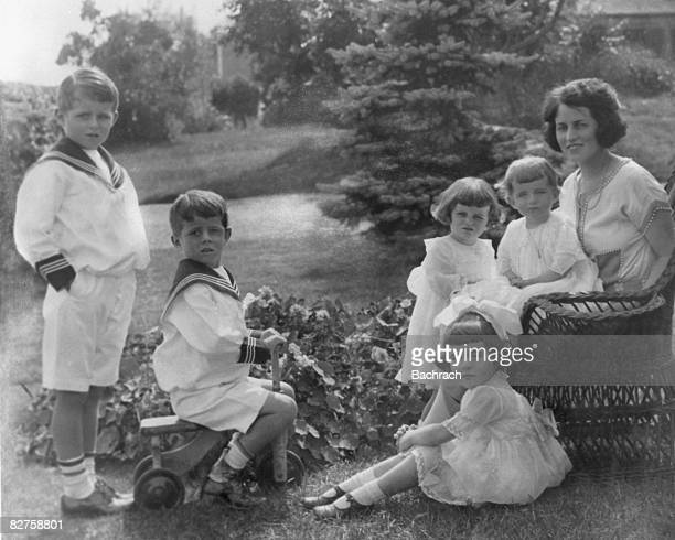 Seated at right American socialite and philanthrophist Rose Kennedy poses with her children from left Joseph P Kennedy Jr John F Kennedy Kathleen...
