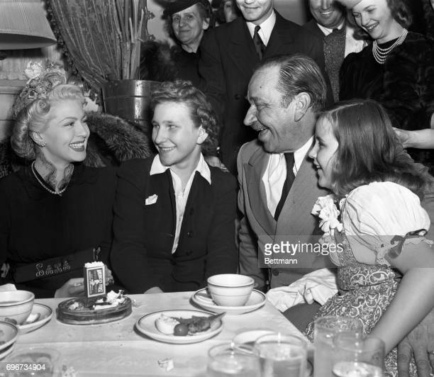 Seated at the President's birthday ball is left to right Lana Turner Anna Sklepovich Wallace Beery and Carol Ann Beery Wallace's daughter
