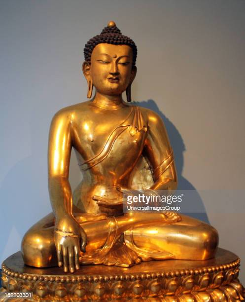 Seated Buddha Chinese 17401786 is shown just before his enlightenment Gilded copper