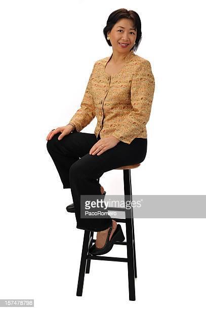 Chinesische Geschäftsfrau sitzend