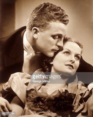 Seated couple embracing : Stock Photo