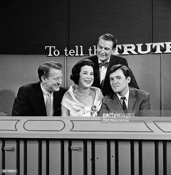 Seated from left American game show panellists and actors Tom Poston Kitty Carlisle and Orson Bean sit with host Bud Collyer 1908 1969 on the set of...
