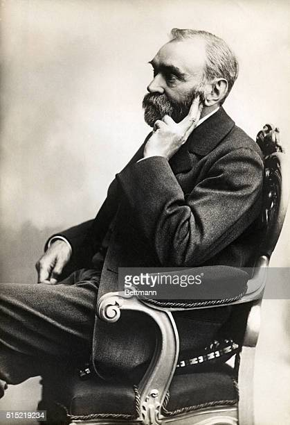 Seated portrait of Alfred Nobel He is shown in near profile with his hand to his beard Undated photograph