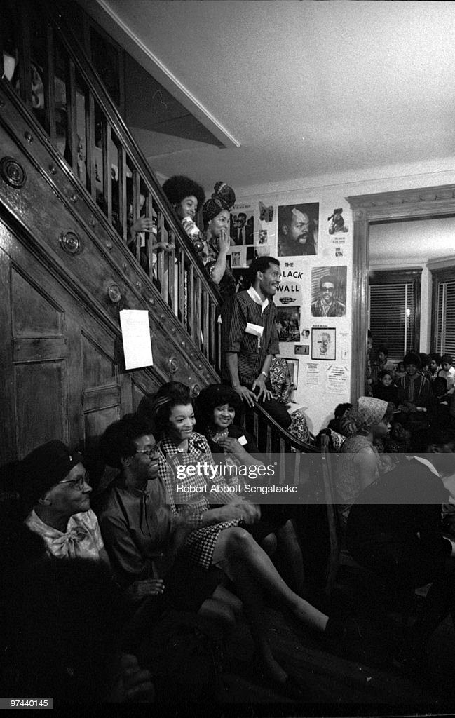 Seated second from left, poet Gwendolyn Brooks (1917 - 2000) sits while listening to friends, family, and fellow literary figures celebrate her 50th birthday, Chicago, June 1967.