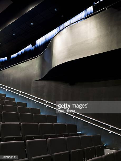 Seating and curved balcony in main auditorium Vagen Videregaende Skole Academy School Europe Norway Link Arkitektur AS