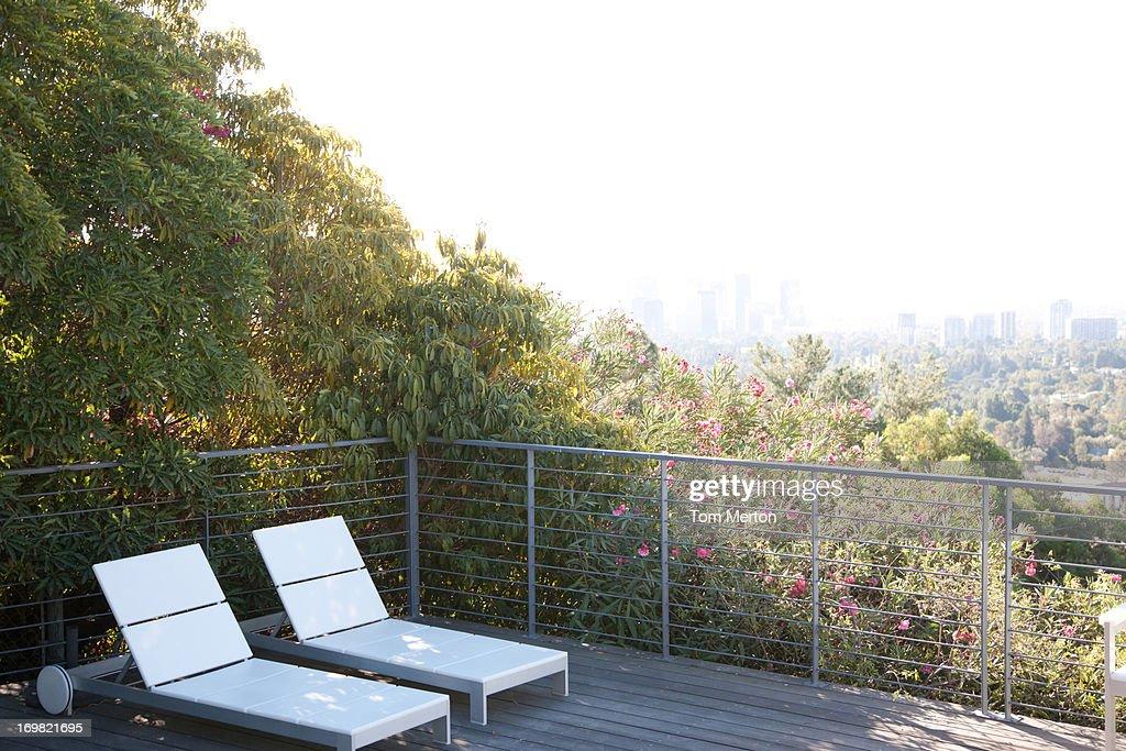 Seating area overlooking cityscape : Stock Photo
