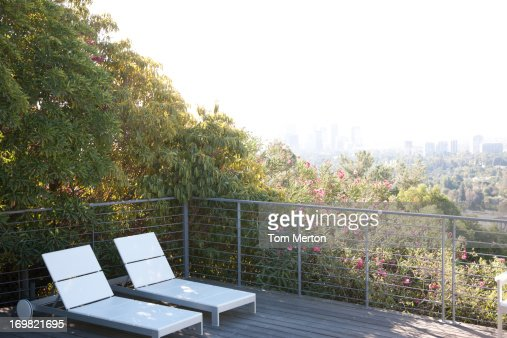 Seating area overlooking cityscape : Stock Photo