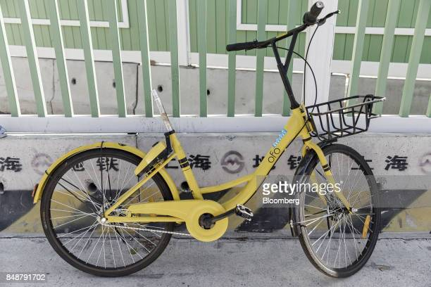 A seatless Ofo Inc bicycle stands against a wall in Shanghai China on Thursday Sept 12 2017 Across Chinese cities sidewalks are filling up with...