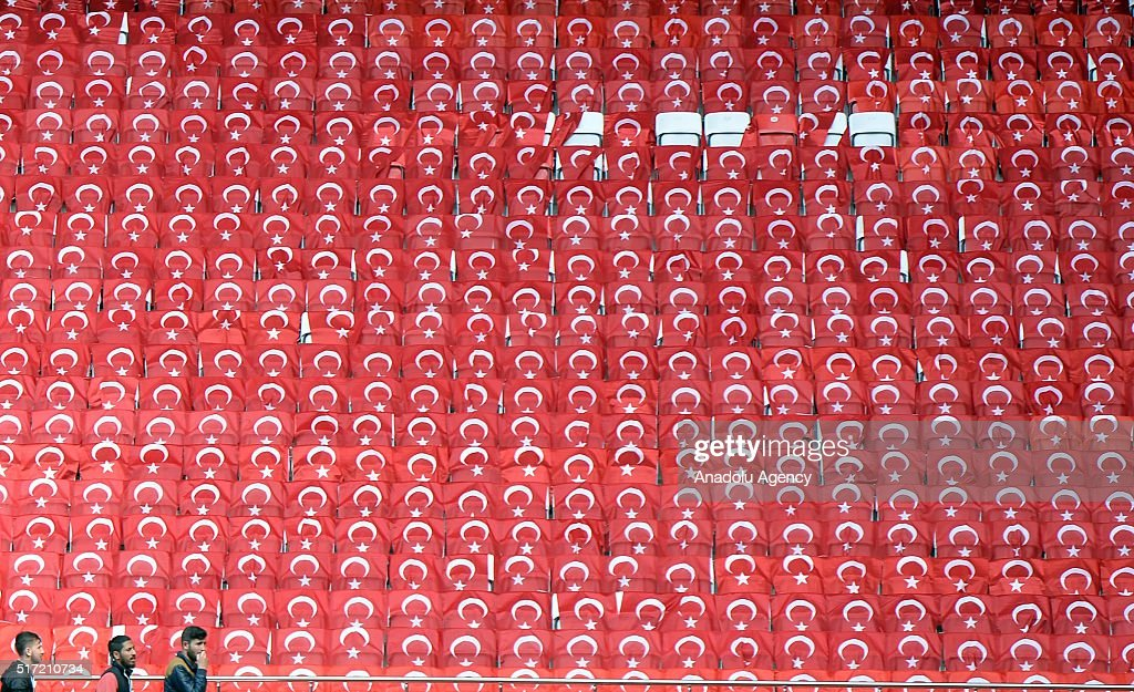 Seats covered with Turkish flags are seen at the stands of the Antalya Stadium ahead of the football match between Turkey and Sweden in Antalya...