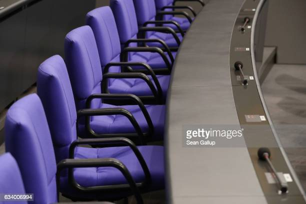 Seats for members of government stand inside the plenary hall of the Bundestag during preparations for the upcoming session of the Federal Assembly...