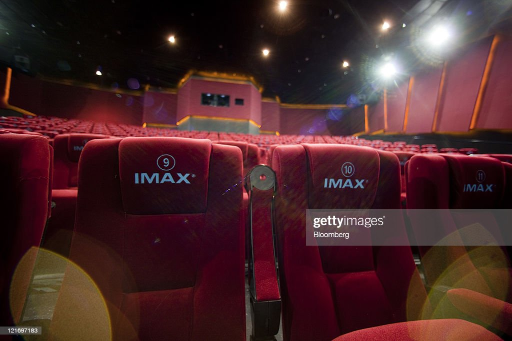 Seats in a theater display the Imax Corp. logo at a cinema in Beijing, China, on Thursday, Aug. 18, 2011. Box office receipts in China grew 64 percent last year to 10.2 billion yuan ($1.6 billion), according to the State Administration of Radio, Film and Television. Photographer: Nelson Ching/Bloomberg via Getty Images