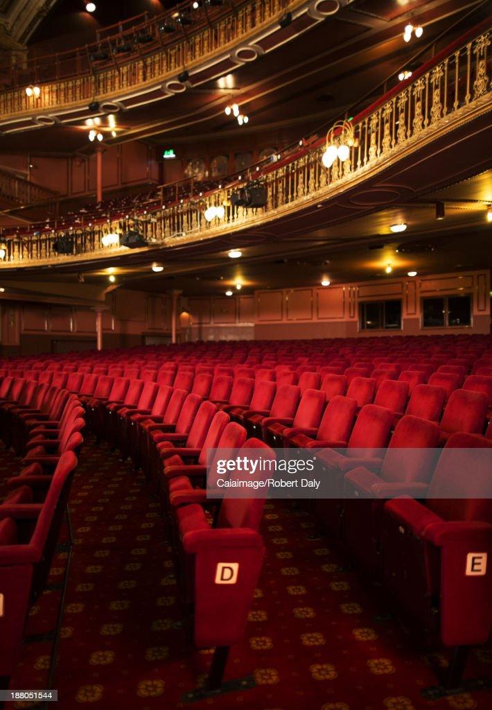 Seats in empty theater auditorium : Stock Photo