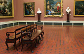 Seats in hall of National Gallery.