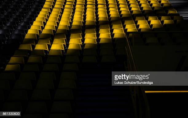 Seats of the tribune are lit by the sun prior to the Bundesliga match between Borussia Dortmund and RB Leipzig at Signal Iduna Park on October 14...