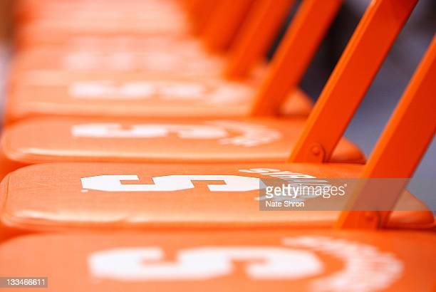 Seats on the Syracuse bench with the Syracuse Orange logo are seen prior to the game against the Colgate Raiders at the Carrier Dome on November 19...