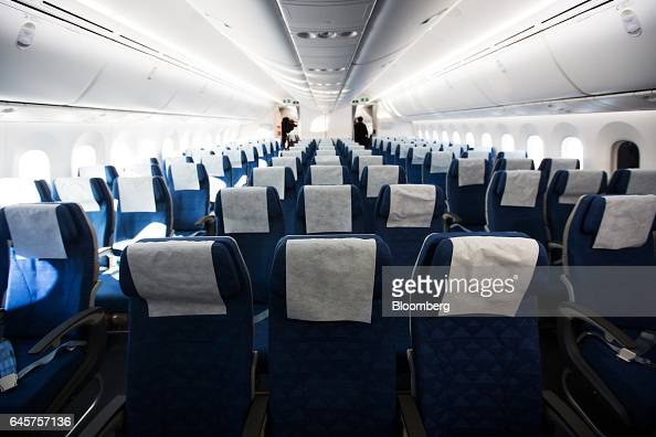 Seats stand in the economy class cabin of a Boeing Co 7879 Dreamliner passenger aircraft operated by Korean Air Lines Co during a media preview at...