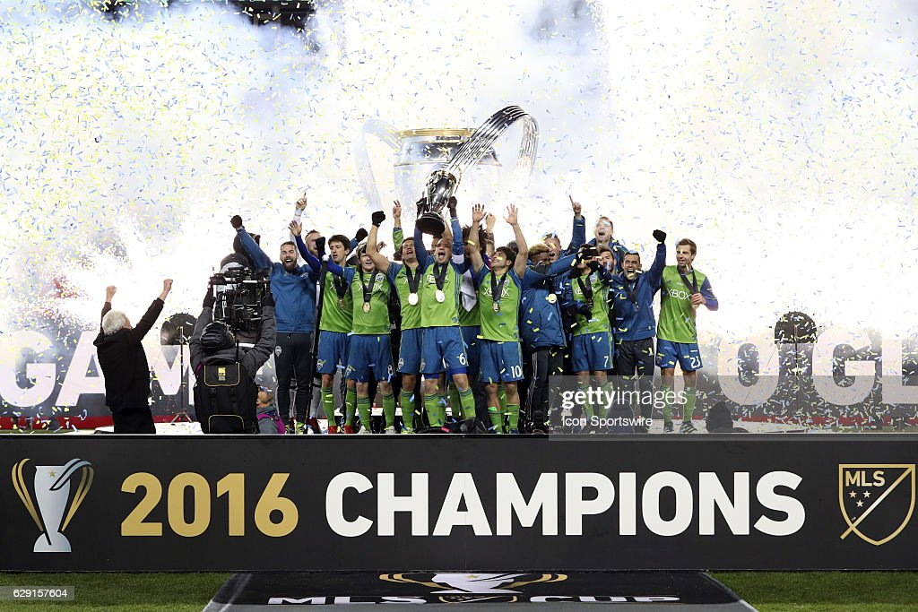 Seattle captain Osvaldo Alonso (CUB) holds the Philip F. Anschutz Trophy overhead while celebrating with his team. Toronto FC hosted Seattle Sounders FC in MLS Cup 2016 at BMO Field in Toronto, Ontario in Canada. Seattle won the championship 5-4 on penalty kicks after the game ended in a 0-0 tie after extra time.