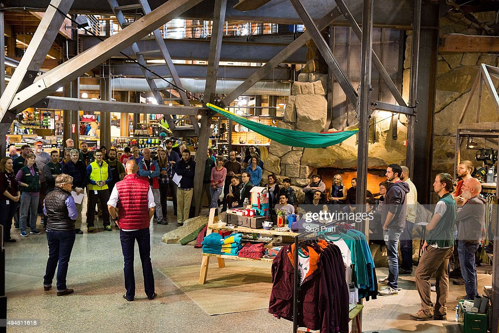 Seattle flagship store employees gather after news that all 143 stores will close on Black Friday and the specialty outdoor retailer will pay all...