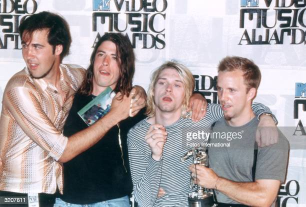 Seattle grunge band Nirvana at the MTV Video Music Awards with their 'moonman' for best alternative video 'In Bloom' Left to right Kris Novoselik...