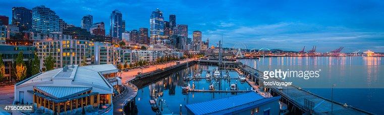 Seattle harbor waterfront apartments skyscrapers illuminated dusk panorama Washington USA