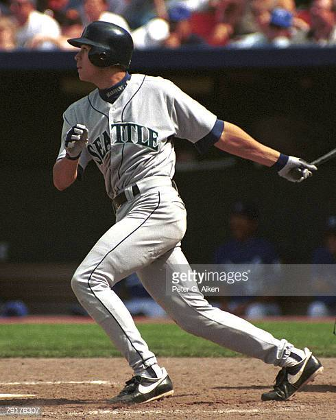 Seattle Mariner Alex Rodriguez drives a hit to right field against the Kansas City Royals at Kauffman Stadium in Kansas City Missouri in 1995