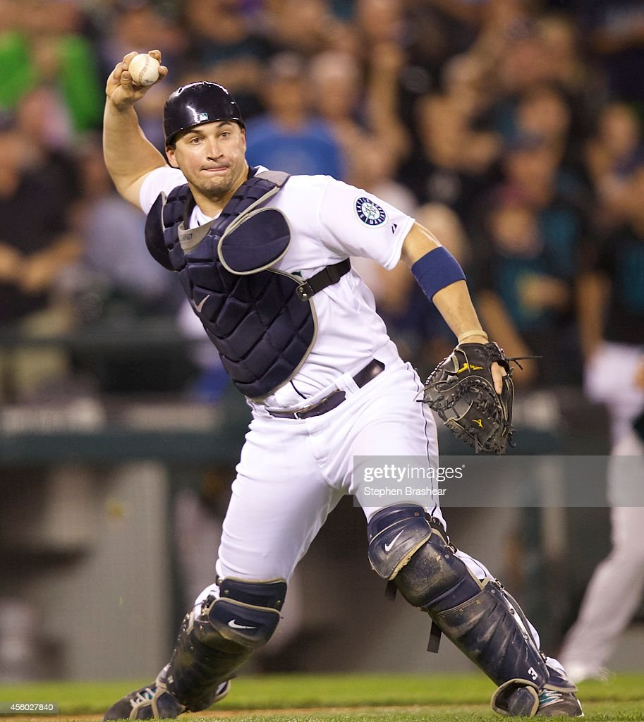 Seattle Mariners catcher <a gi-track='captionPersonalityLinkClicked' href=/galleries/search?phrase=Mike+Zunino&family=editorial&specificpeople=6803368 ng-click='$event.stopPropagation()'>Mike Zunino</a> #3 throws to first base during a baseball game against the Oakland Athletics at Safeco Field on September 13, 2014 in Seattle, Washington.
