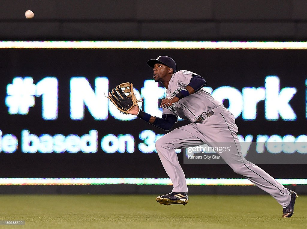 Seattle Mariners center fielder James Jones runs down the third out of the sixth inning on a fly ball by Kansas City Royals' Eric Hosmer on Tuesday...