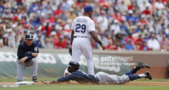 Seattle Mariners center fielder James Jones triples in the fourth inning as Texas Rangers third baseman Adrian Beltre waits for a throw from the...