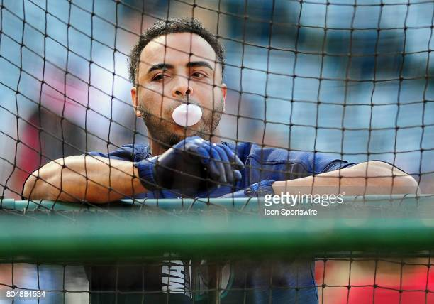 Seattle Mariners designated hitter Nelson Cruz blowing a bubble and leaning on the batting cage during batting practice before a game against the Los...