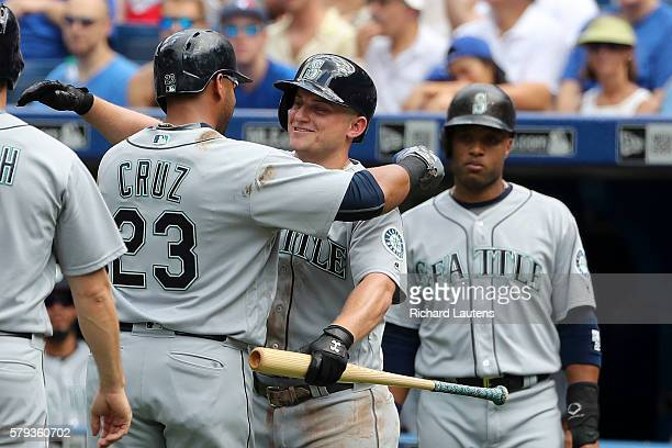 TORONTO ON JULY 23 Seattle Mariners designated hitter Nelson Cruz gets a big hug from Seattle Mariners third baseman Kyle Seager after Cruz' grand...