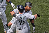 TORONTO ON JULY 23 Seattle Mariners designated hitter Nelson Cruz hits a 3 run shot in the 8th and celebrates with Seattle Mariners third baseman...