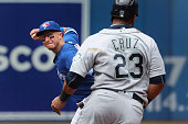 TORONTO ON JULY 24 Seattle Mariners designated hitter Nelson Cruz is out at second on a double play in the second inning as Toronto Blue Jays...
