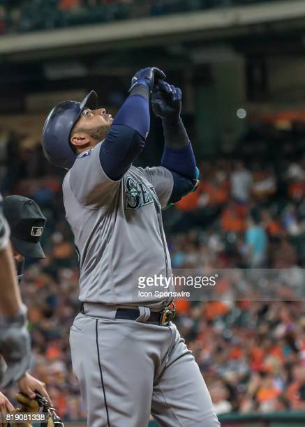 Seattle Mariners designated hitter Nelson Cruz says a prayer of thanks after homering in the seventh inning of the MLB game between the Seattle...