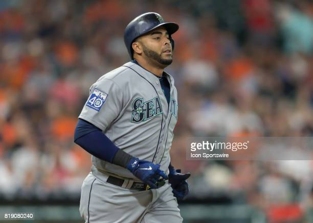 Seattle Mariners designated hitter Nelson Cruz takes off for first base after being hit by a pitch in the first inning of the MLB game between the...