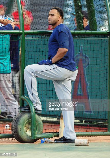 Seattle Mariners designated hitter Nelson Cruz with a foot on the batting cage during batting practice before a game against the Los Angeles Angels...