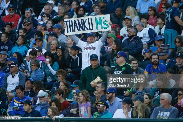 Seattle Mariners fan holds a sign during the seventh inning stretch of the game against the Oakland Athletics at Safeco Field on October 4 2015 in...