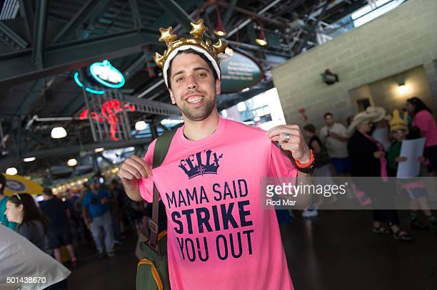 Seattle Mariners fan is seen wearing a crown and a Mama Said Strike You Out tshirt during the game between the Seattle Mariners and the Oakland...