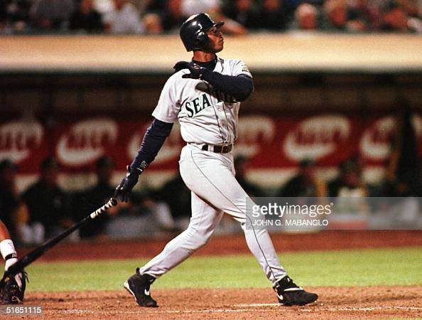 Seattle Mariners Ken Griffey Jr watches his second home run sail out of the park 22 September against the Oakland Athletics in Oakland CA The home...