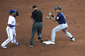 TORONTO ON JULY 22 Seattle Mariners left fielder Norichika Aoki signals that Toronto Blue Jays second baseman Devon Travis was late on the tag and he...