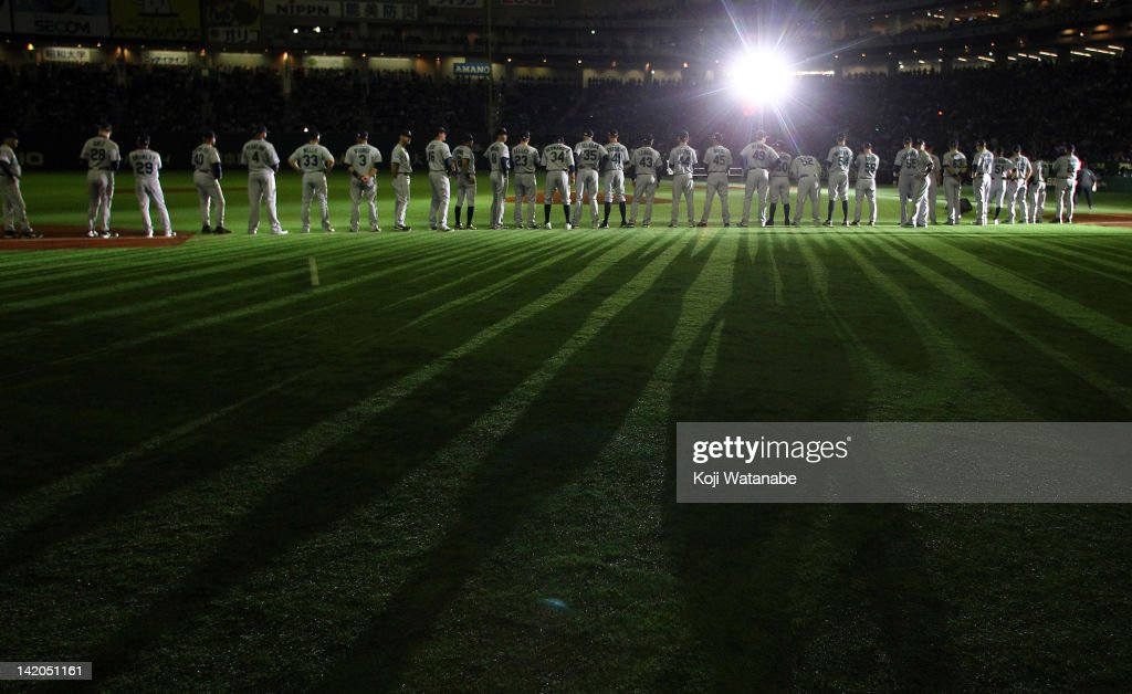 Seattle Mariners line up for national anthem during MLB match between Seattle Mariners and Oakland Athletics at Tokyo Dome on March 29, 2012 in Tokyo, Japan.