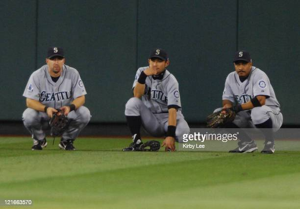 Seattle Mariners outfielders Raul Ibanez Ichiro Suzuki and Jason Ellison huddle during a pitching change in a 125 victory over the Los Angeles Angels...