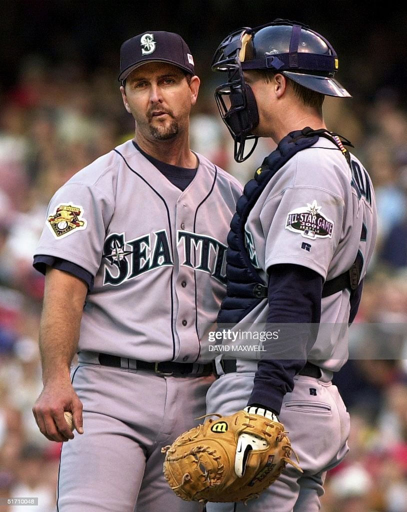 Seattle Mariners pitcher Paul Abbott talks to catcher Dan Wilson with the bases loaded against the Cleveland Indians during the third inning of the...