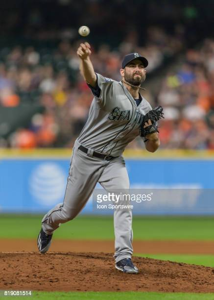 Seattle Mariners relief pitcher Tony Zych relieves Seattle Mariners relief pitcher James Pazos in the bottom of the sixth inning of the MLB game...