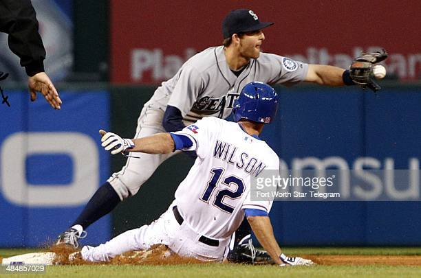 Seattle Mariners shortstop Brad Miller forces out the Texas Rangers' Josh Wilson at second before turning the double play at Globe Life Park in...