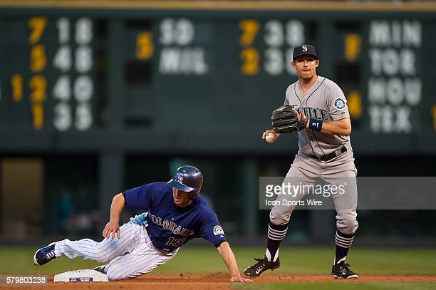 Seattle Mariners shortstop Brad Miller looks down a runner after forcing out Colorado Rockies center fielder Drew Stubbs during a regular season...