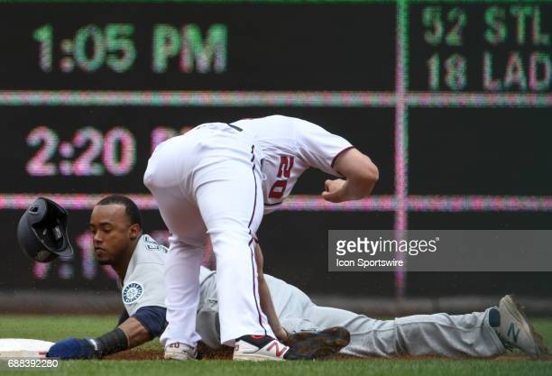 Seattle Mariners shortstop Jean Segura is tagged out by Washington Nationals second baseman Daniel Murphy on a steak attempt in the first inning on...