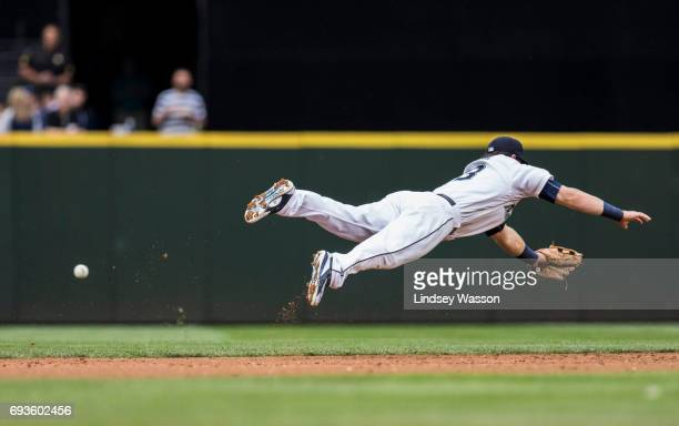 Seattle Mariners shortstop Tyler Smith dives but can't get to a line drive from Minnesota Twins second baseman Brian Dozier scoring Minnesota Twins...