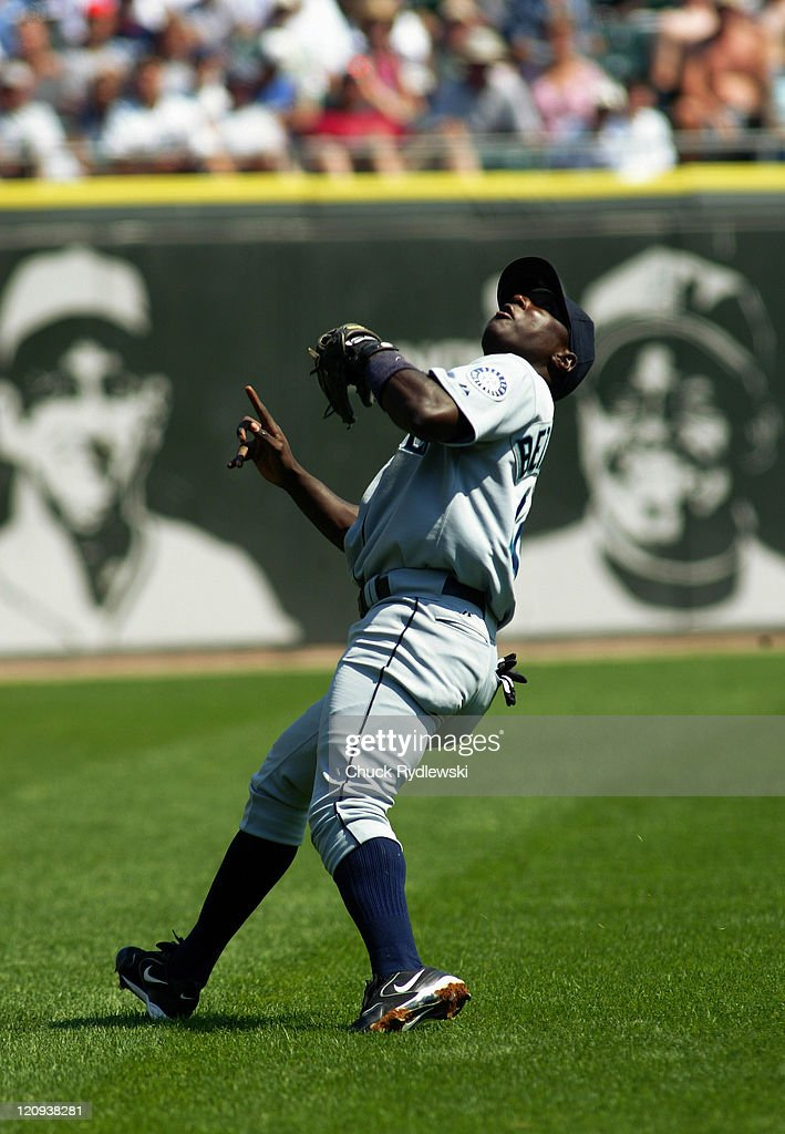 Seattle Mariners' Shortstop Yuniesky Betancourt chases down a pop fly during the game against the Chicago White Sox August 7 2005 at US Cellular...